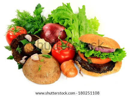 Ingredients (Lettuce, Red Onion, Tomato, Portobello Mushrooms), Seasonings (Plain Parsley, Shallot, Dill, Garlic Cloves) for cooking Vegetarian Grilled Mushrooms Burger, Burger itself over white.   - stock photo