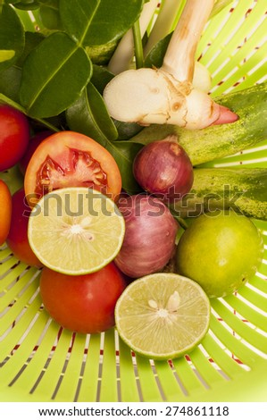 Ingredients of Thai spicy food in green basket - stock photo