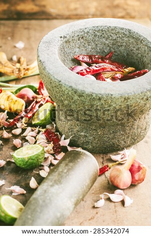 Ingredients of Thai spicy food with mortar ,tom yum - stock photo
