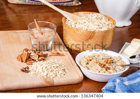 Ingredients on a table to prepare a hot bowl of oatmeal