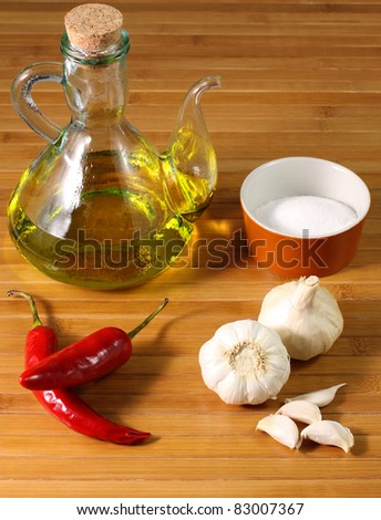 Ingredients: Salt, oil, garlic and chilli - stock photo