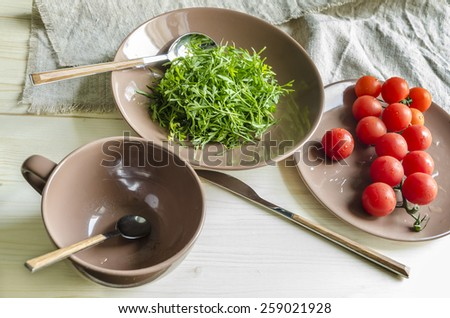 Ingredients watercress salad with cherry tomatoes. From series Natural organic food - stock photo