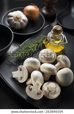 Ingredients with fresh mushrooms on black background - stock photo
