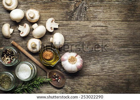 Ingredients with fresh mushrooms on wooden background