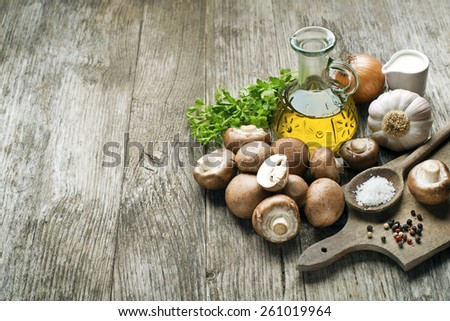 Ingredients with fresh mushrooms on wooden background - stock photo