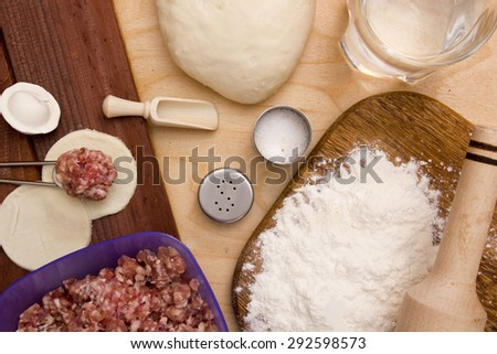 Ingredinenty for cooking dumplings with meat and unleavened dough.