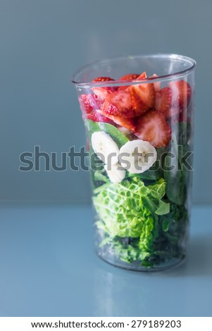 Ingridients for a healthy green smoothie, healthy combo mix drink with kale, strawberries and banana