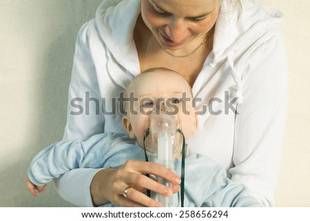 inhalation child makes baby mama - stock photo