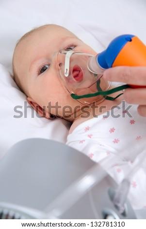 inhaling baby - stock photo