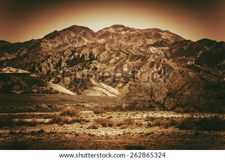 Inhospitable Desert Landscape in Death Valley California, United States. Browny Vintage Color Grading. - stock photo