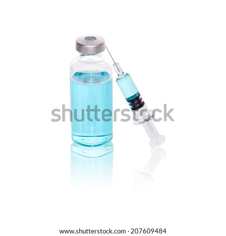Injecting medicine with a vial and glass syringe - stock photo