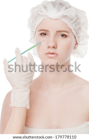 Injection in the female face. Eye and eyebrow zone. Isolated on white - stock photo