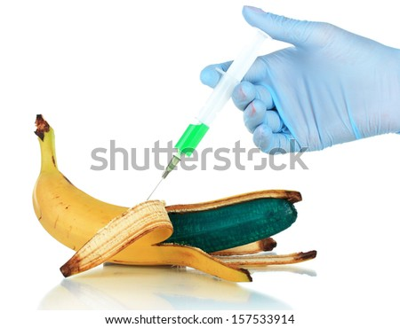 Injection into banana isolated on white - stock photo