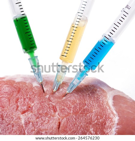Injection into fresh meat on white background - stock photo