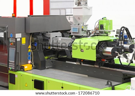 Injection moulding machine for plastic parts production - stock photo