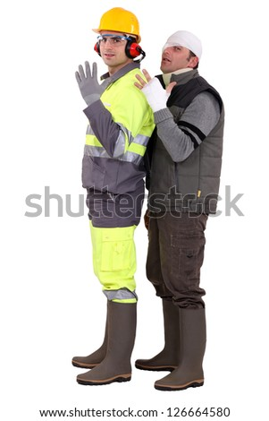 Injured builder badaged-up - stock photo