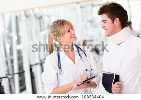 Injured man at the doctor wearing a cervical collar - stock photo