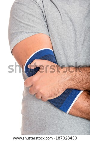 Injured, pain - Man with a therapeutic elastic band on his elbow isolated on white - stock photo