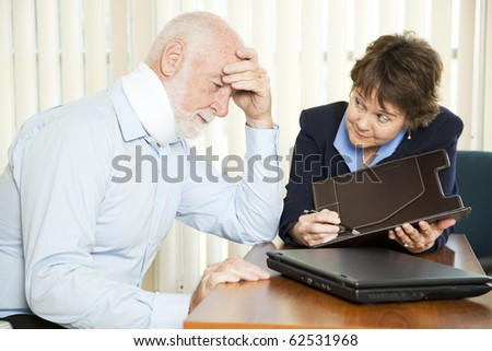 Injured senior man and his accountant worrying about the cost of medical bills.