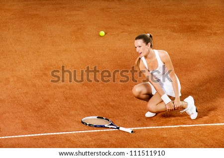 Injured tennis female player crying from pain - stock photo