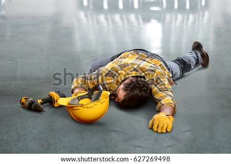 Injured worker laying on concrete floor