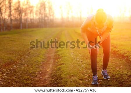Injuries - sports running knee injury on woman - stock photo