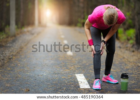 Injuries - sports running knee injury on woman