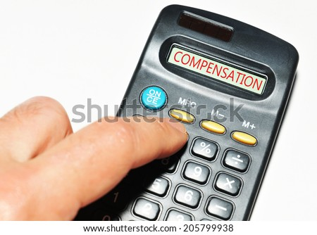 Injury claim concept with hand and calculator - stock photo