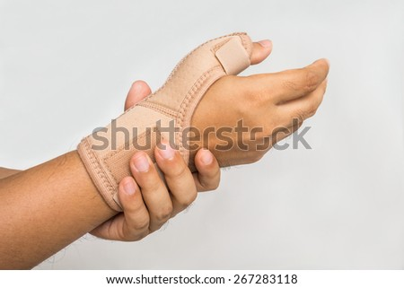 Injury hand with wrist supporter  - stock photo