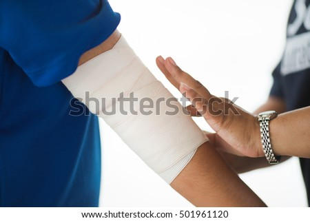 Injury hands. Young girl with injured hands. Young woman doctor helps the patient