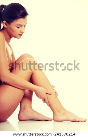 Injury. Woman holding on leg. - stock photo
