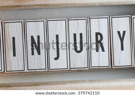 INJURY word on wood blocks concept - stock photo