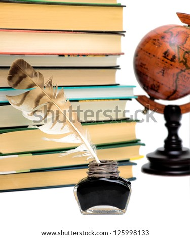 ink and pen, a stack of books and a globe on a white background