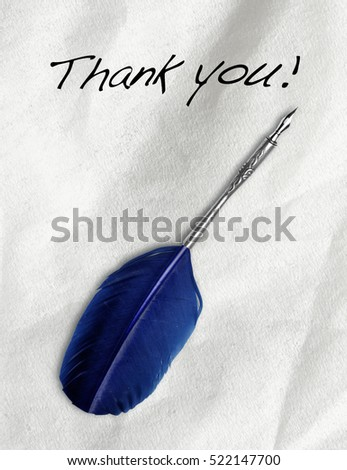 "Ink feather tool write ""thank you"" on White paper"