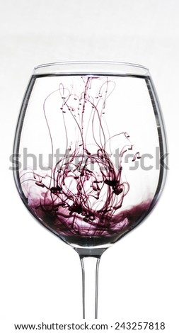ink in a glass of water - stock photo