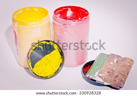 ink in the plastic jars.ink printing t shirts - stock photo