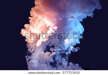 ink in water isolated on a black background - stock photo
