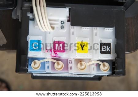 Ink jet printer cartridge refilling - stock photo