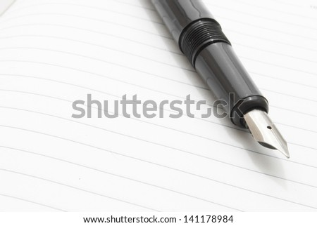ink pen on ruled paper - stock photo