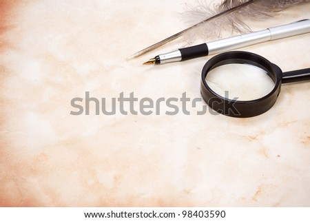 ink pen on vintage ancient paper background texture - stock photo