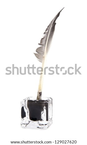 ink-pot and feather on a white background