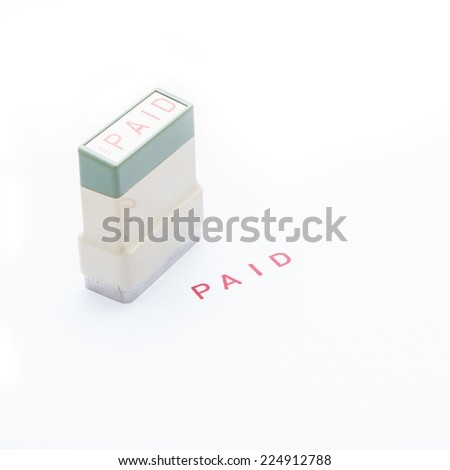 Ink stamp paid. - stock photo