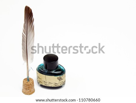 Inkwell and pen - stock photo