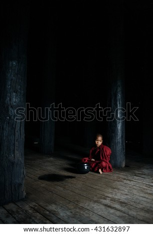 INLE LAKE-MARCH 29 :monk  posing in a temple on March 29, 2015 in Inle Lake, Myanmar