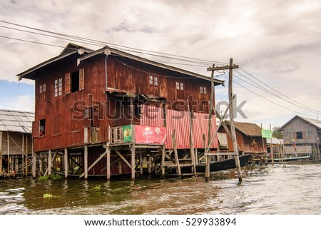 INLE LAKE, MYANMAR - AUG 30, 2016: Beautiful view of the Inpawkhon village over the Inle Sap,a freshwater lake in the Nyaungshwe Township of Taunggyi District of Shan State, Myanmar
