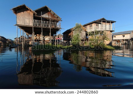 INLE LAKE, MYANMAR, December 14, 2014 : Houses on the Lake. People built on the water its houses on piles and lives on culture of fruits, vegetables and flowers on incredible floating islands