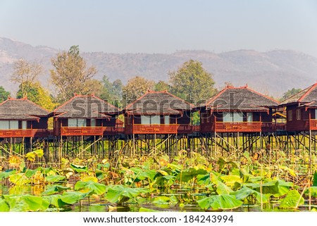INLE LAKE, MYANMAR - FEBRUARY 28, 2013: Replica of the traditional floating village engineered as a hotel with bungalows.