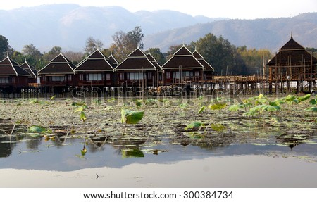 INLE LAKE, MYANMAR - MAR 1, 2015 - Dusk, Floating cottages of Hupin Hotel on  Inle Lake,  Myanmar (Burma)