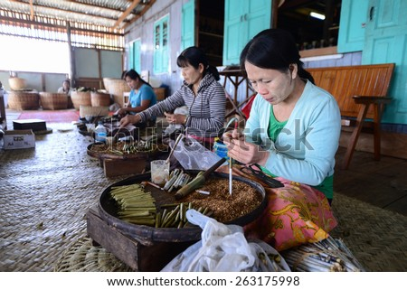 INLE LAKE, MYANMAR, SEPTEMBER 5: Unidentified Burmese women make cigar manual in a cigar production place on September 5, 2013 in Inle Lake, Myanmar. Inle lake is very famous for cigar in Myanmar.  - stock photo