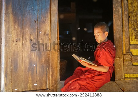 INLE, MYANMAR - DEC 8: Unidentified young buddhism novice at Shwe Yan Pyay Temple on Dec 8, 2014 in Inle. Buddhism is predominantly of the Theravada tradition, practised by 89% of the population. - stock photo